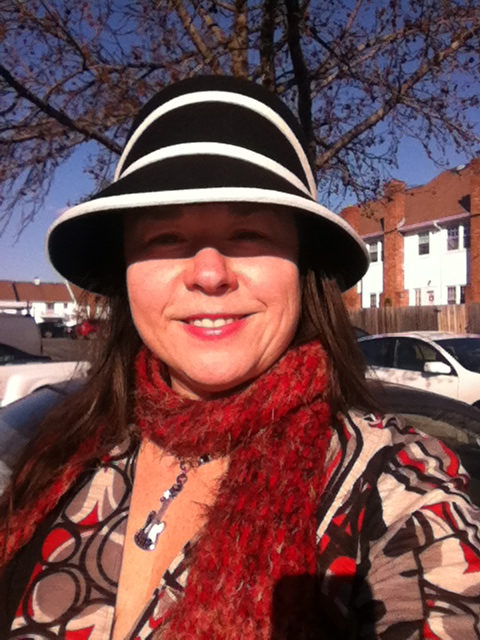 Close up of new hat, awesome necklace by my sis-in-law, with funny fuzzy scarf.  Burts Bees Lip Shimmer in Merlot